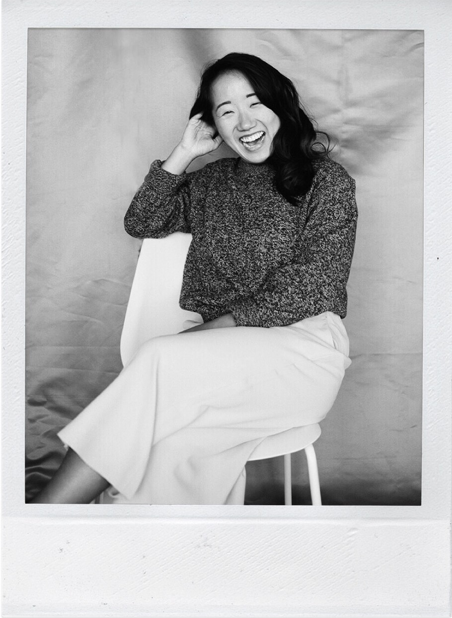 woman sitting on chair laughing