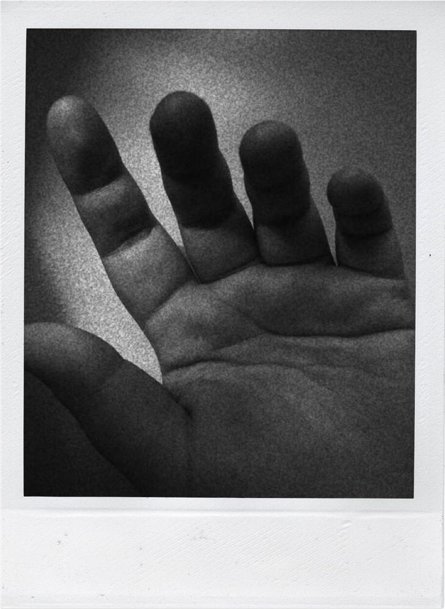 polaroid of womans hand
