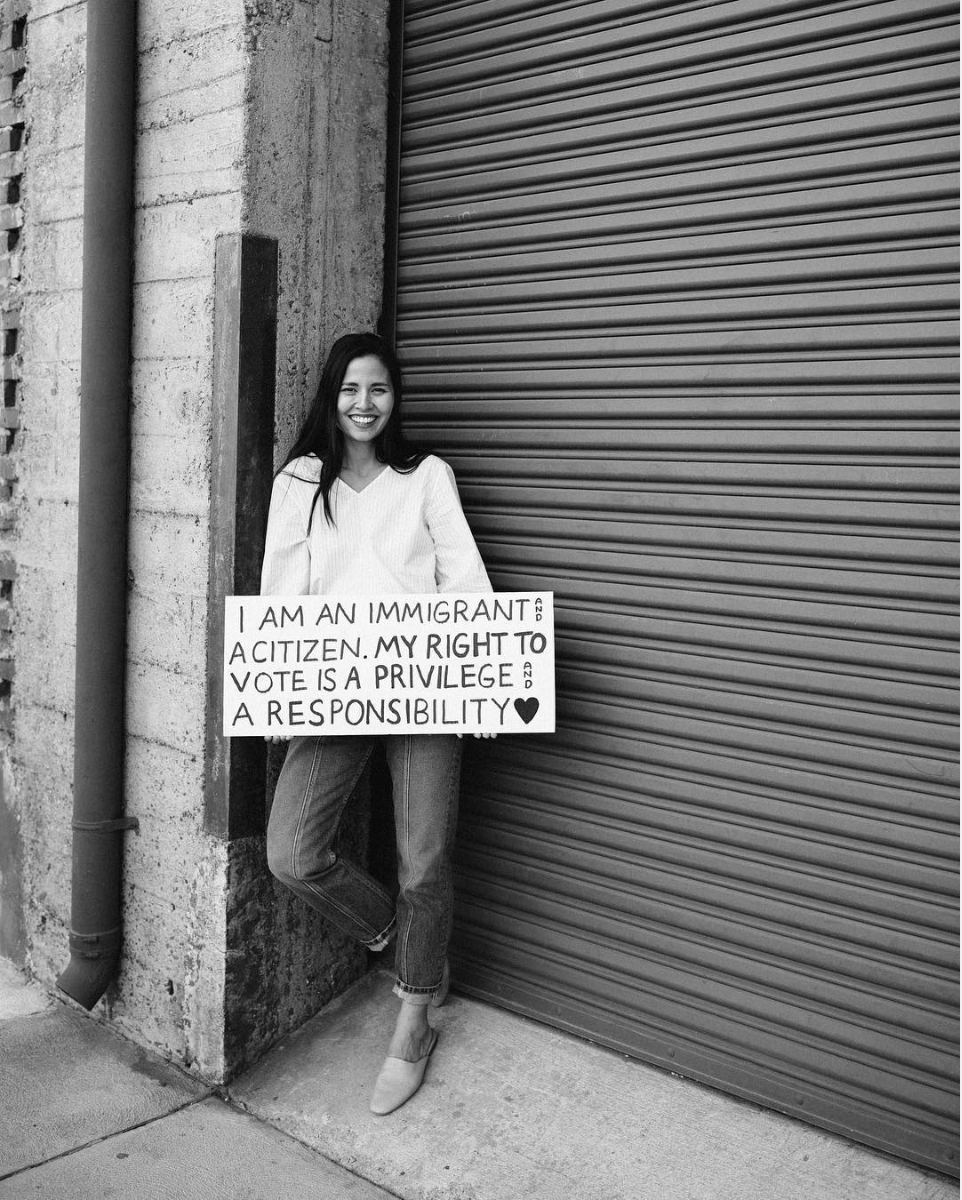 black and white image of woman with sign