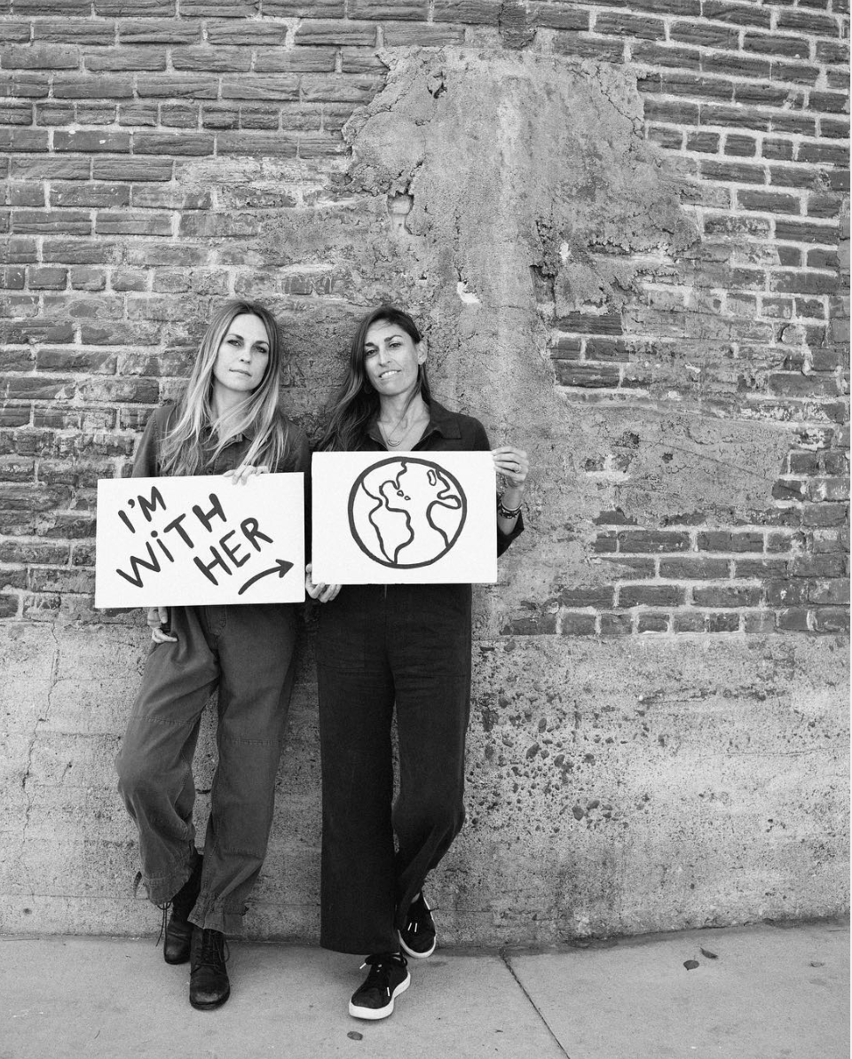 black and white image of two women holding signs