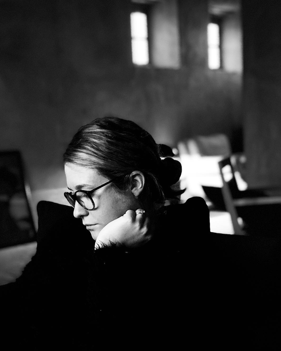 black and white image of woman sitting alone