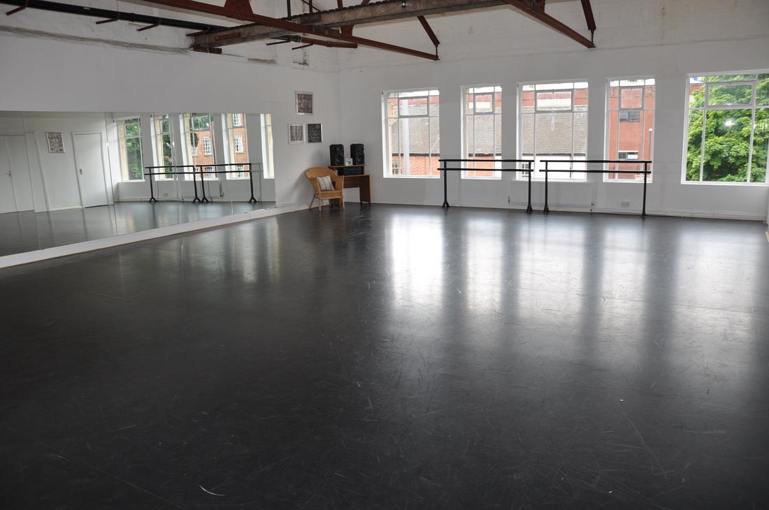 Studio Size : 8.4m x 11.5m - Location : 2nd Floor : Our largest studio - Sprung Floor - Harlequin Vinyl : Sealed permanent flooring - High Ceiling - Mirrors