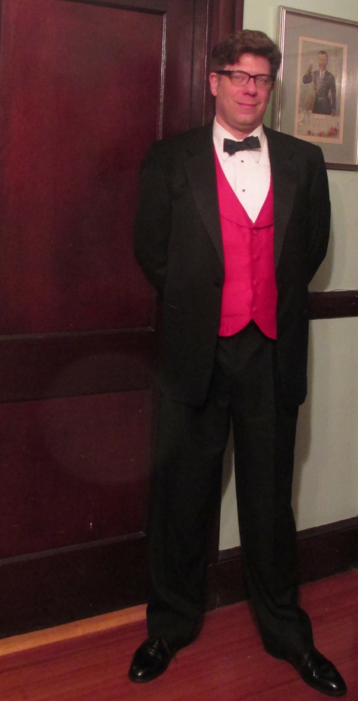 "Etiquetteer a few years ago with a Perfectly Proper satin bow tie, exercising the privilege of ""creative black tie"" with that red vest."