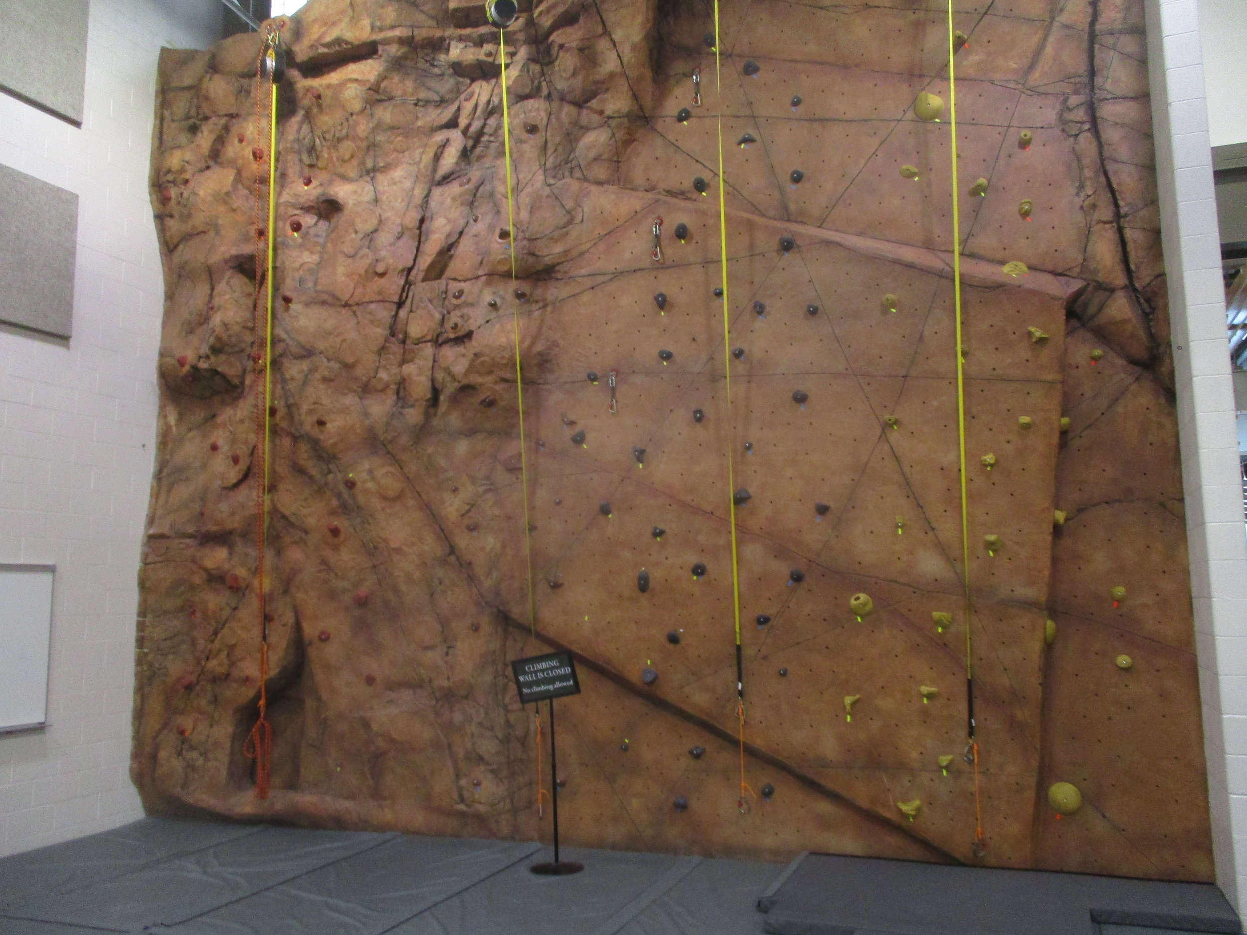 They have a rock wall in the new gym.