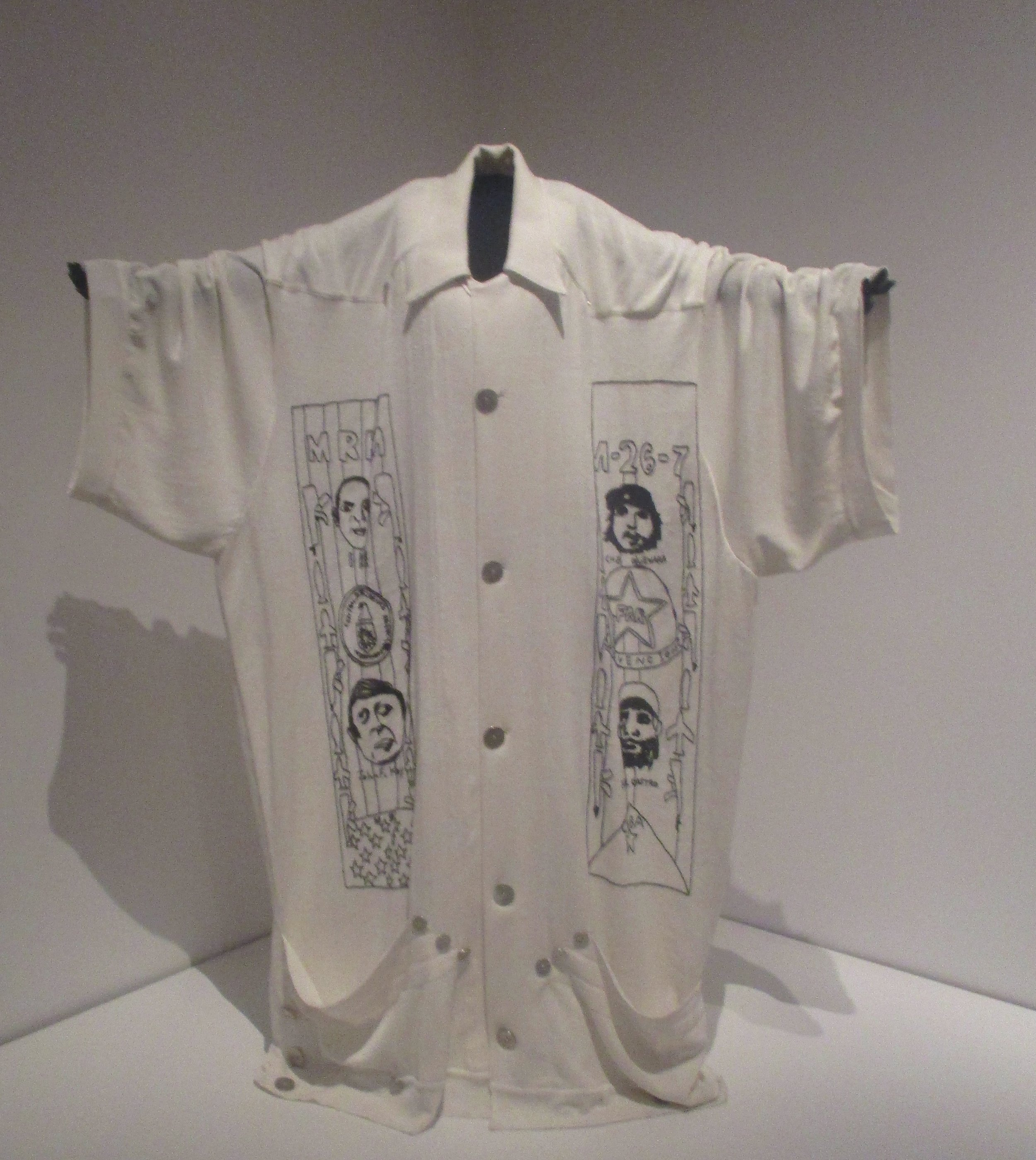 A playful take on the guayabera. I would  totally  wear this to the White Party, but without those gigantic pockets at the hem.