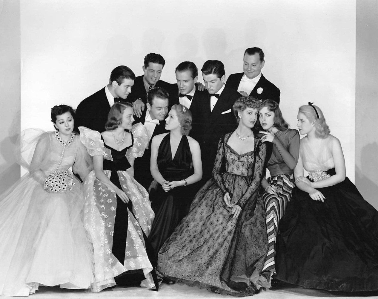 "The principal cast of  These Glamour Girls : Front row: Ann Rutherford (Mary Rose), Jane Bryan (Carol), Lew Ayres (Phil), Lana Turner (Jane), Anita Louise (Daphne), Marsha Hunt (Betty), Mary Beth Hughes (Ann). Second row: Tom Browne (Homer), Owen Davis, Jr. (Greg), Richard Carlson (Joe), Peter Lind Hayes (Skel), and Sumner Getchell (""Blimpy""). Missing: Tom Collins (Tommy)."