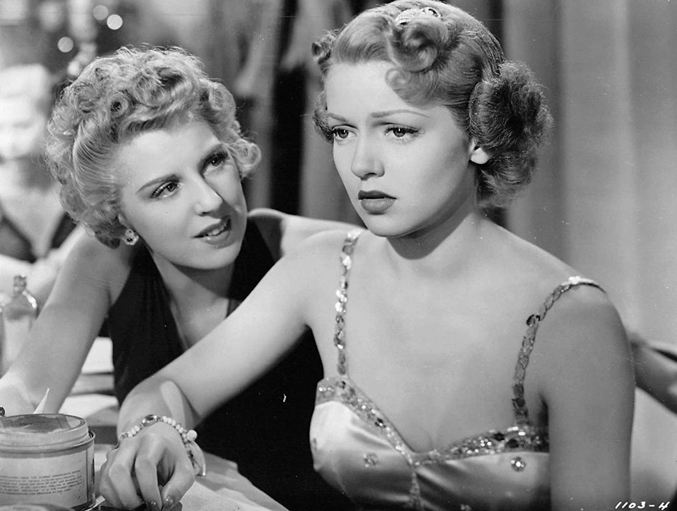 Dennie Moore provides Lana Turner with some serious advice at the Joy Lane.