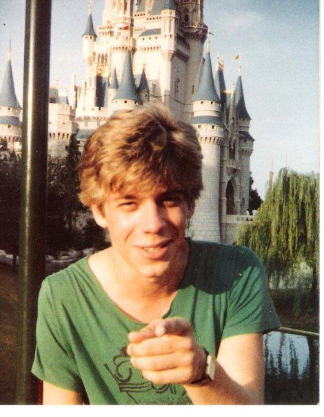 On a family trip to the Magic Kingdom, July, 1982 or 1983. Note the cutout neck of the T-shirt and blame  Flashdance .