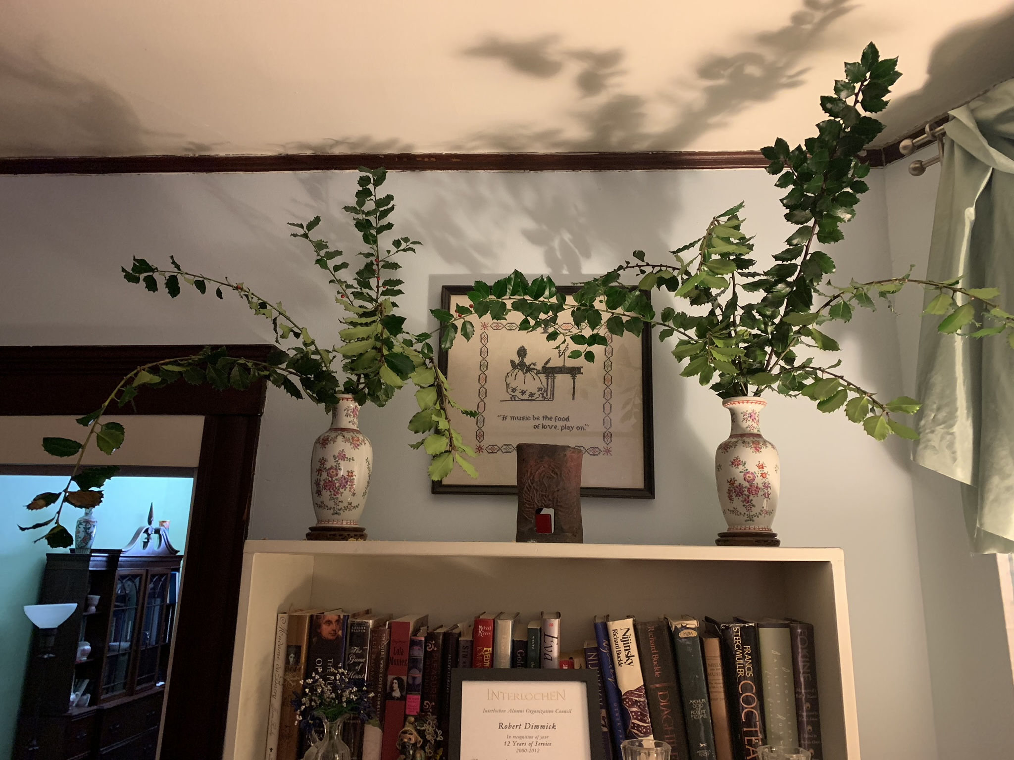Holly I harvested from my garden last weekend in the parlor for Christmas decoration.