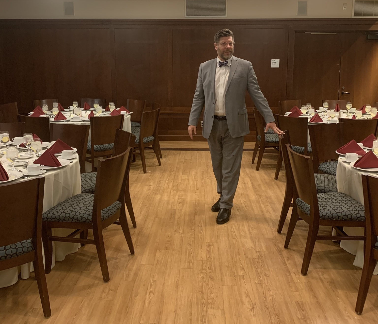 Waiting for the arrival of dinner guests at last week's How to Adult etiquette dinner at MIT.