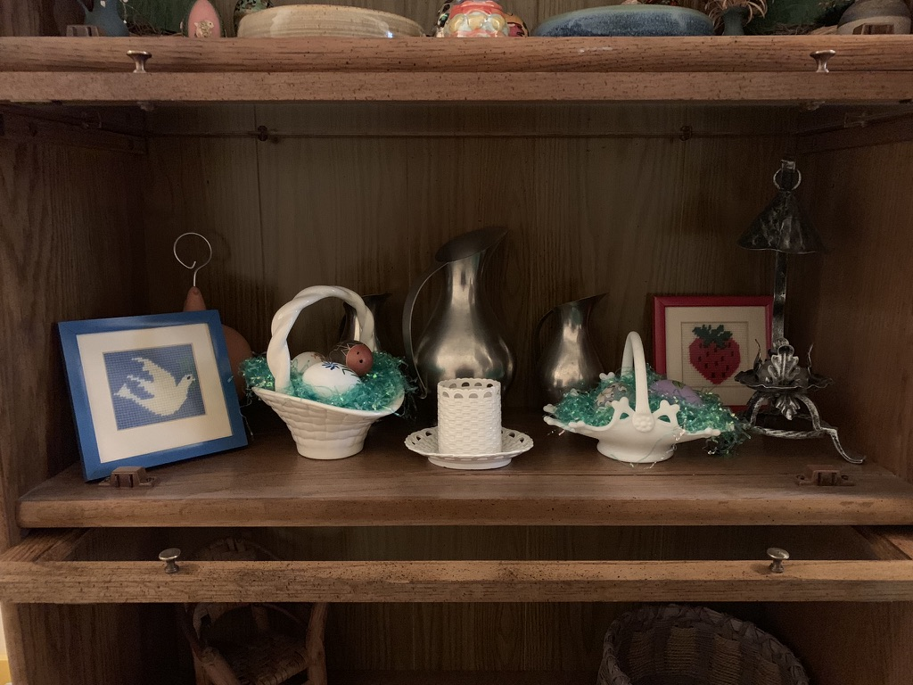 A shelf of decorative items, including some of her egg collection, in the back hall.