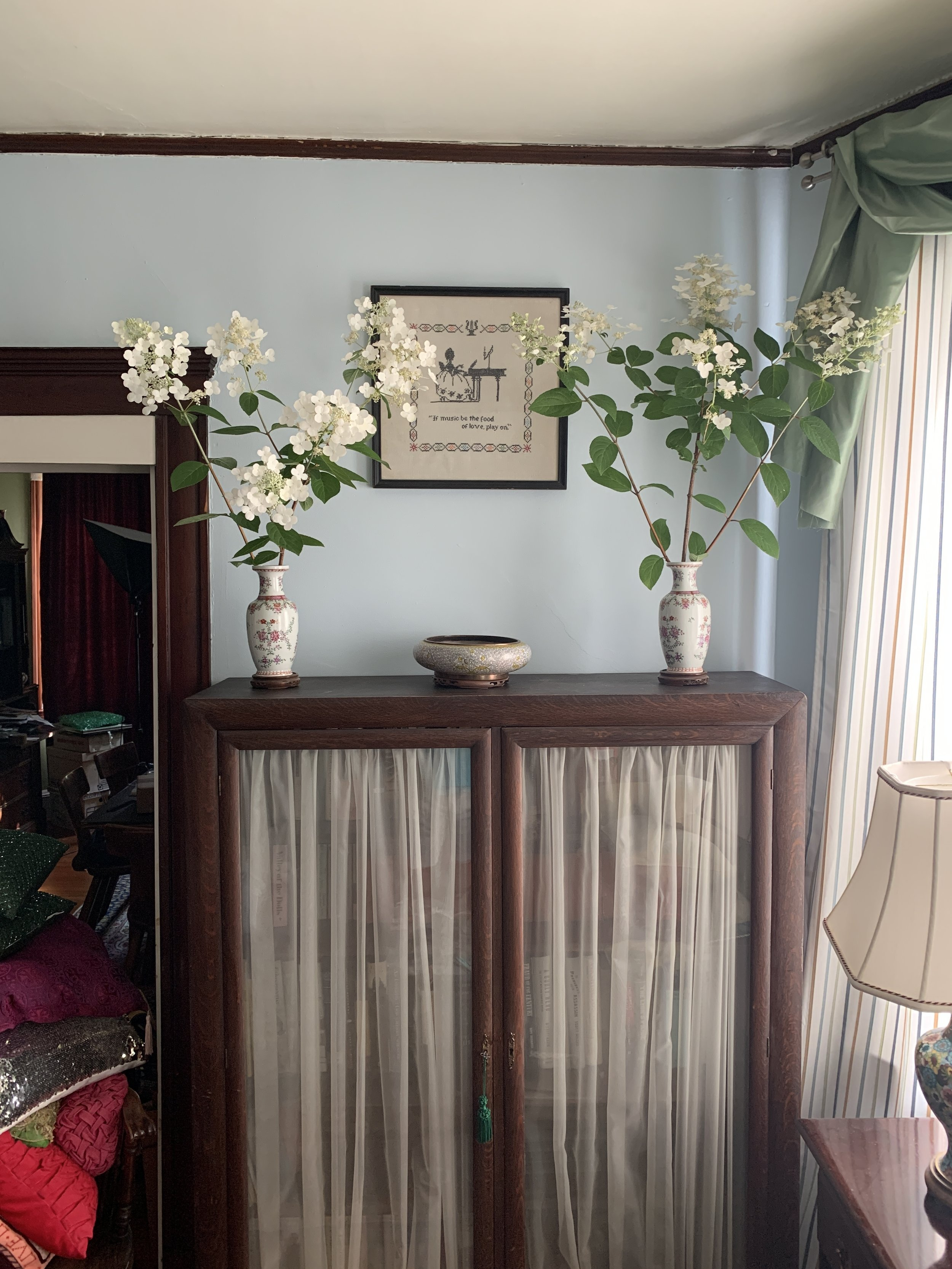 The cabinet was left behind in the first home my parents owned after their marriage. The vases were my grandmother's veiled in shadows on a high obscure shelf in her den. I always knew they should be more in the spotlight.