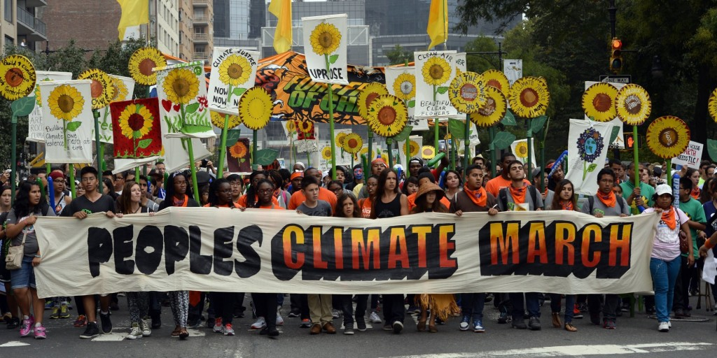 Marchers make their way across Central Park South during the People's Climate March on September 21 2014, in New York. Activists mobilized in cities across the globe Sunday for marches against climate change, with one of the biggest planned for New York, where celebrities, political leaders and tens of thousands of people were expected. The march comes before the United Nations Secretary-General Ban Ki-moon convenes a climate change summit of 120 world leaders . AFP PHOTO/Timothy A. Clary (Photo credit should read TIMOTHY A. CLARY/AFP/Getty Images)