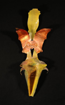 """Pitcher and Bat  24"""" x 9 ."""" x 5 .""""; mixed media A carnivorous pitcher plant in Borneo attracts bats by vibrating. The bat responds to the acoustic welcome, and finds a safe place to roost that is cool and free of parasites. The plant receives nutrients from the bat's droppings. The pitcher plant is unusual in that it attracts the bats for nutrients rather than for pollination."""