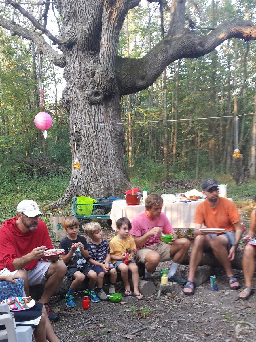 "A community gathers beneath ""Mother Oak"""