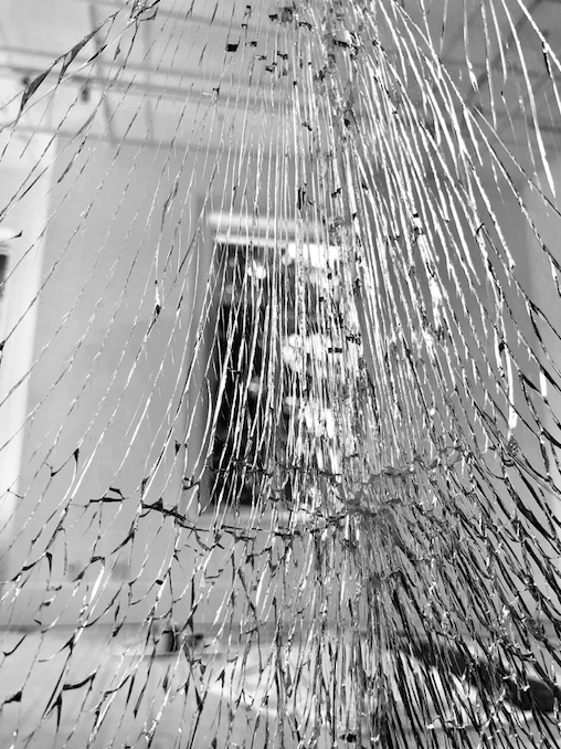 Escape. Window behind a laminated shattered glass panel