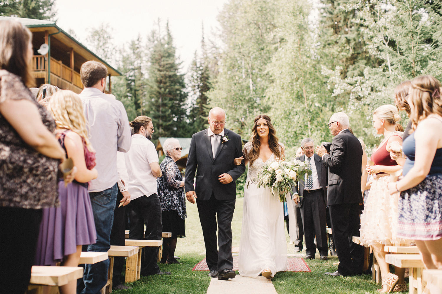 bride walking down aisle, persian rugs aisle, boho chic wedding, golden bc wedding, hillside chalet wedding