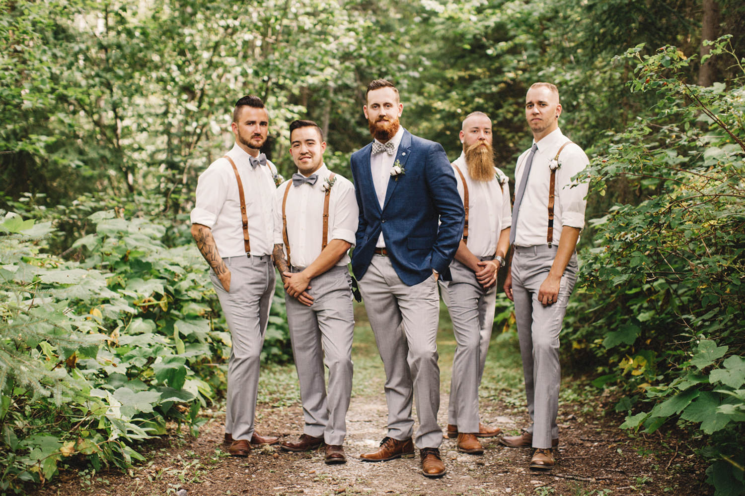 groom and groomsmen, groom in blue suit, suspenders, bow ties, golden wedding, bc wedding photographer