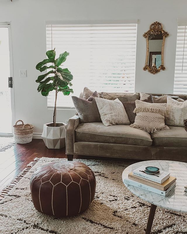 "Home is where my heart is❤️ So cheesy but so true. Always evolving, always moving things around because if I'm not visually stimulated I go nuts. Coffee table not styled but I have a question. I planned on framing the windows for a ""faux shutter"" look (budget friendly) but should I add sheers with a black rod? Yay or Nah? Thanks in advance! #thursday #mood #karinayvettestylehome"