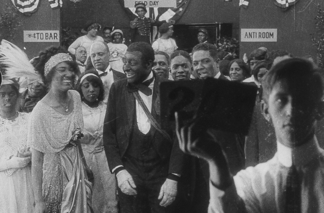 moma :     MoMA Film curators have discovered the  earliest existing footage of a feature film with a black cast . The film will screen at MoMA on November 8 as part of our  To Save and Project  film preservation series.      I believe this claim is incorrect. The oldest films with Black actors that I know of are Thomas Edison's productions of battle scenes from the Philippine American War (1899). African-Americans played the Filipinos. They were produced in West Orange, NJ. You can find the films on the Library of Congress website http://www.loc.gov/item/98501198/