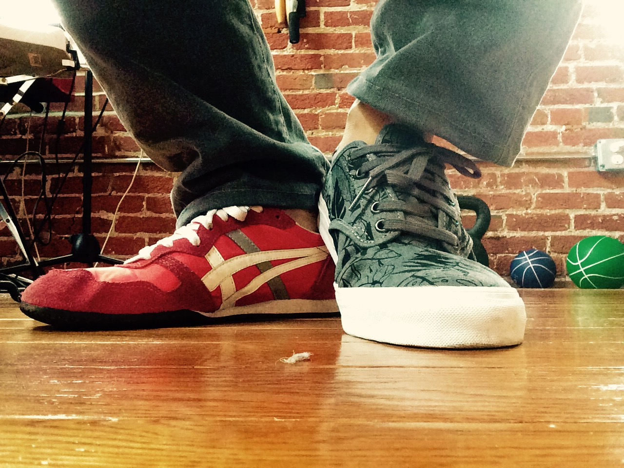 poetsandshoes :     Patrick Rosal (Philadelphia Correction) is reading Silent Anatomies by Monica Ong. Right foot: Tiger Onitsuka (red w white and gray stripe); Left foot Chima Ferguson Pro Vans (Gray Leaf design).