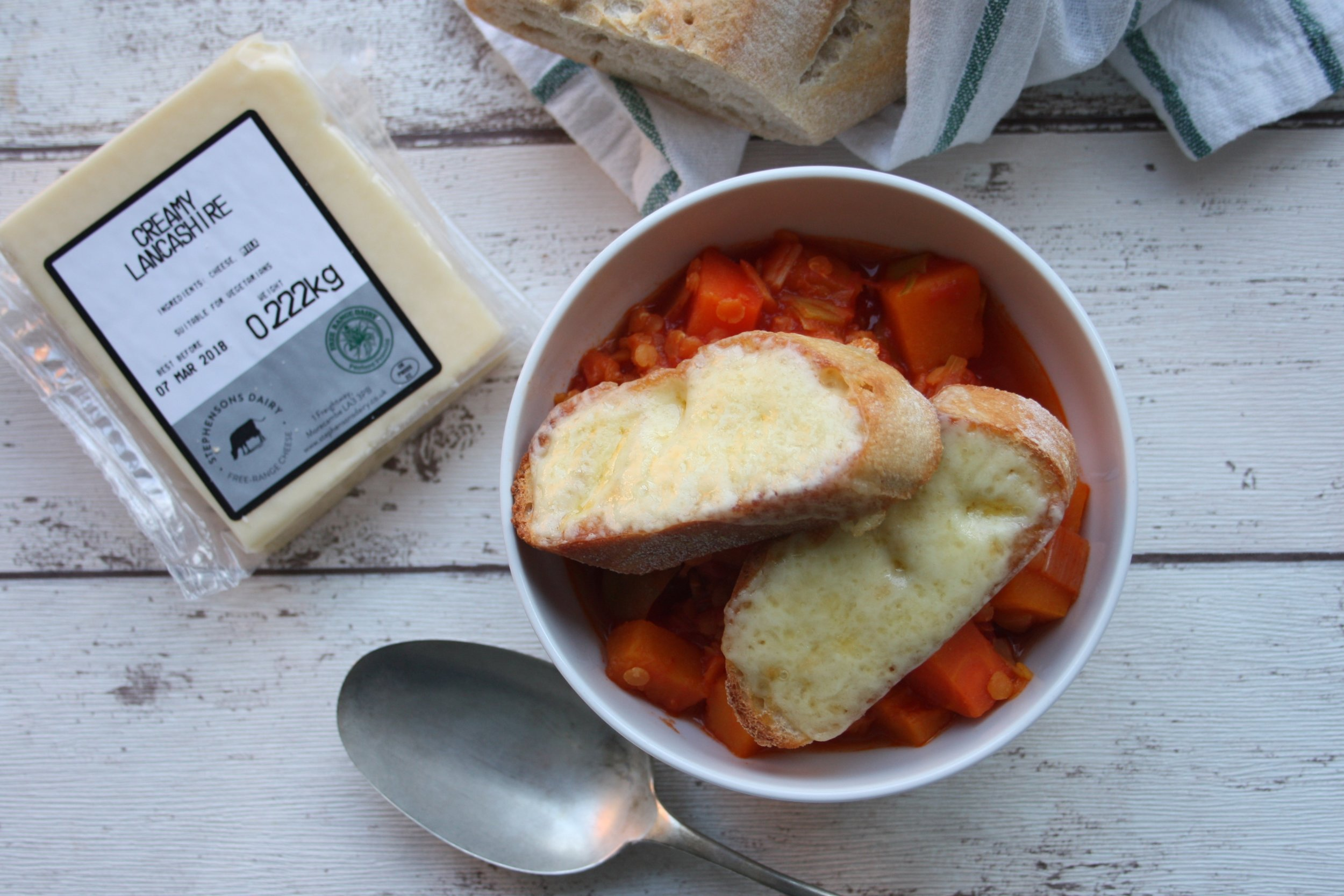 Vegetable Stew with Giant Lancashire Croutons - Serves 4-6For the stew:1 tablespoon olive oil1 clove garlic, crushed (optional)1 onion2 large carrots2 leeks 500g butternut squash1 x 400g tin tomatoes75g red split lentils (rinsed)500ml vegetable stockFor the croutons:1 baguette250g Stephensons Creamy LancashireMethod1. Cut all the vegetables into 1-2cm chunks.2. Heat the oil in a large lidded pan. Add the vegetables (including garlic, if using)and cook, stirring occasionally for 5 minutes. Add all the other ingredients, bring to the boil and simmer gently with the lid on until thickened and the vegetables are tender. This will take 20-35 minutes, depending on the size of your vegetables. Add more water if too thick.3. Meanwhile, prepare the giant croutons by cutting the baguette into 2cm slices and toast lightly. Top with generous slabs of Stephensons Creamy Lancashire.4. Just before serving, grill the croutons and place the desired number of croutons per serving on top of the stew. Make plenty as they are very moreish!