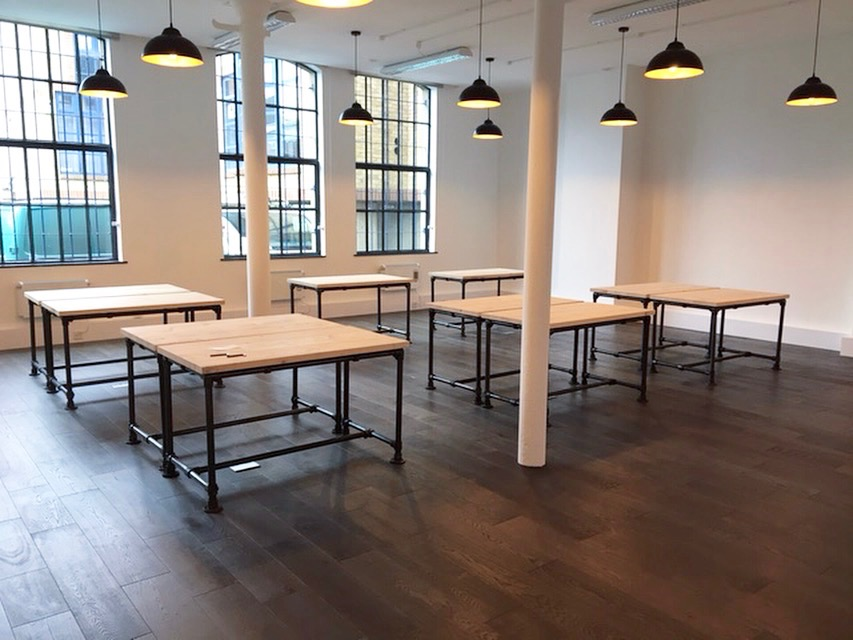 Commercial - London office industrial style styling & bespoke built scaffold board desks with metal piping frames.