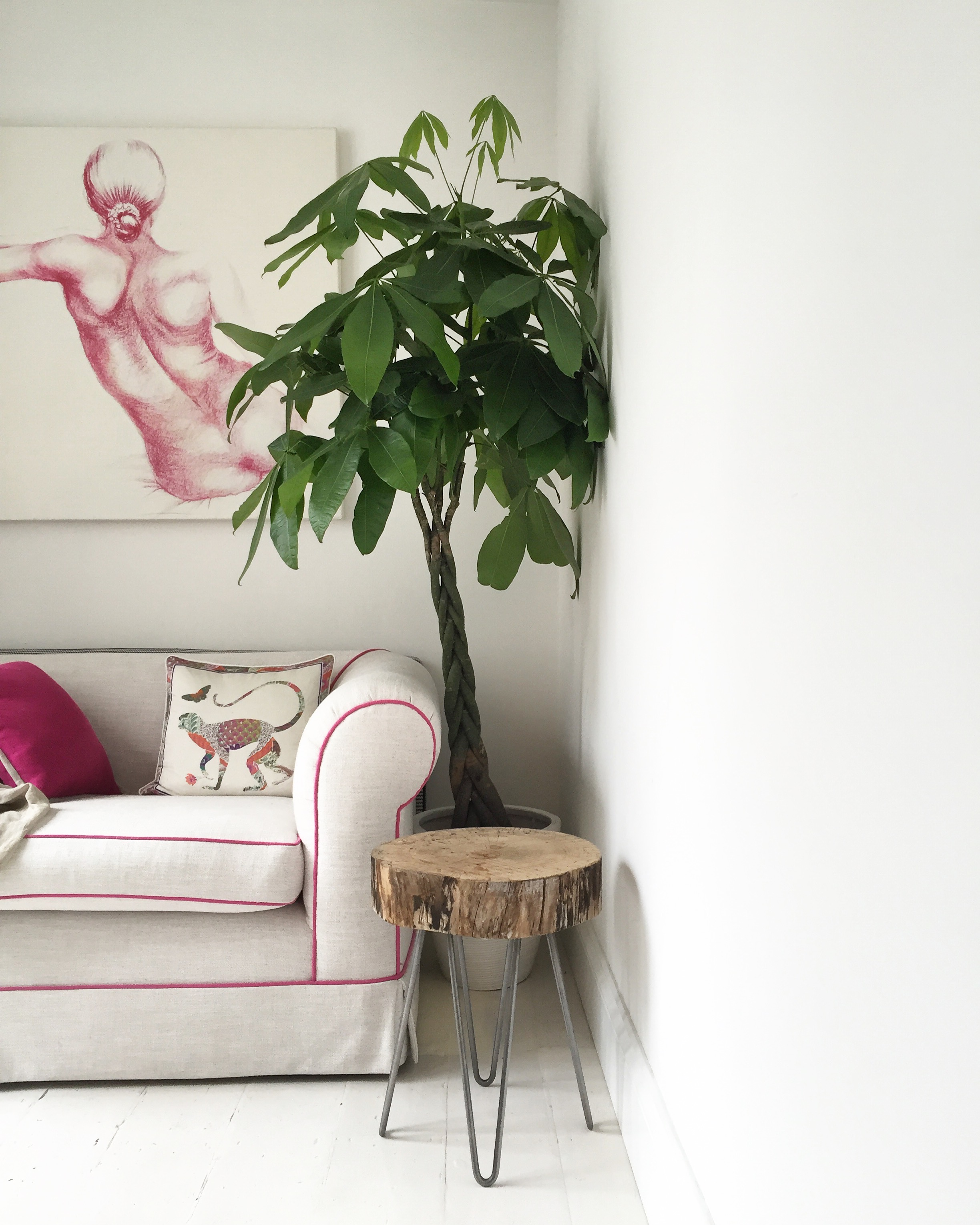 Residential: TV cubby room renovation. Sofa upholstered in natural fabric with bright pink piping to tie in with & accentuate wall art.