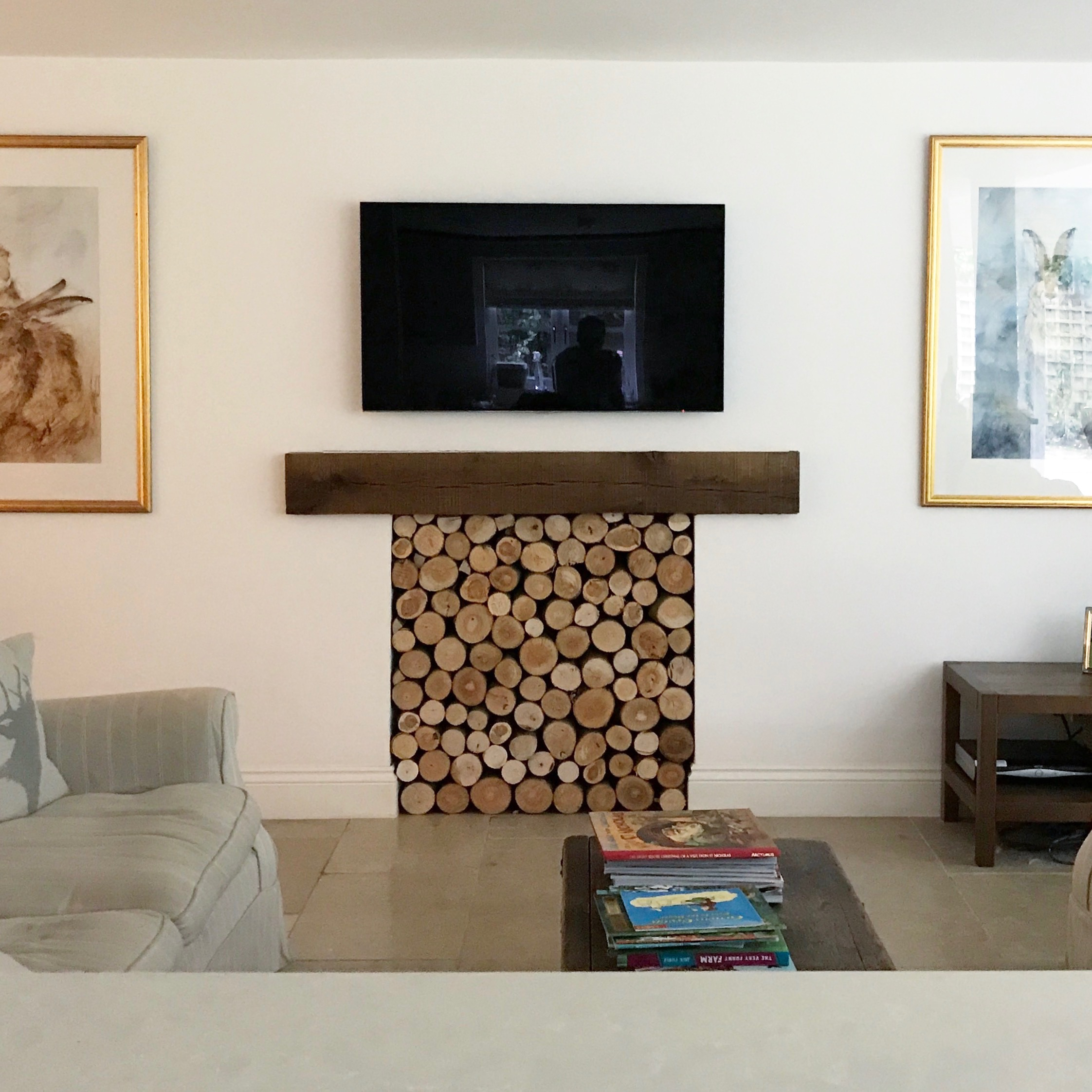 Residential - child friendly natural log feature to replace old fireplace.