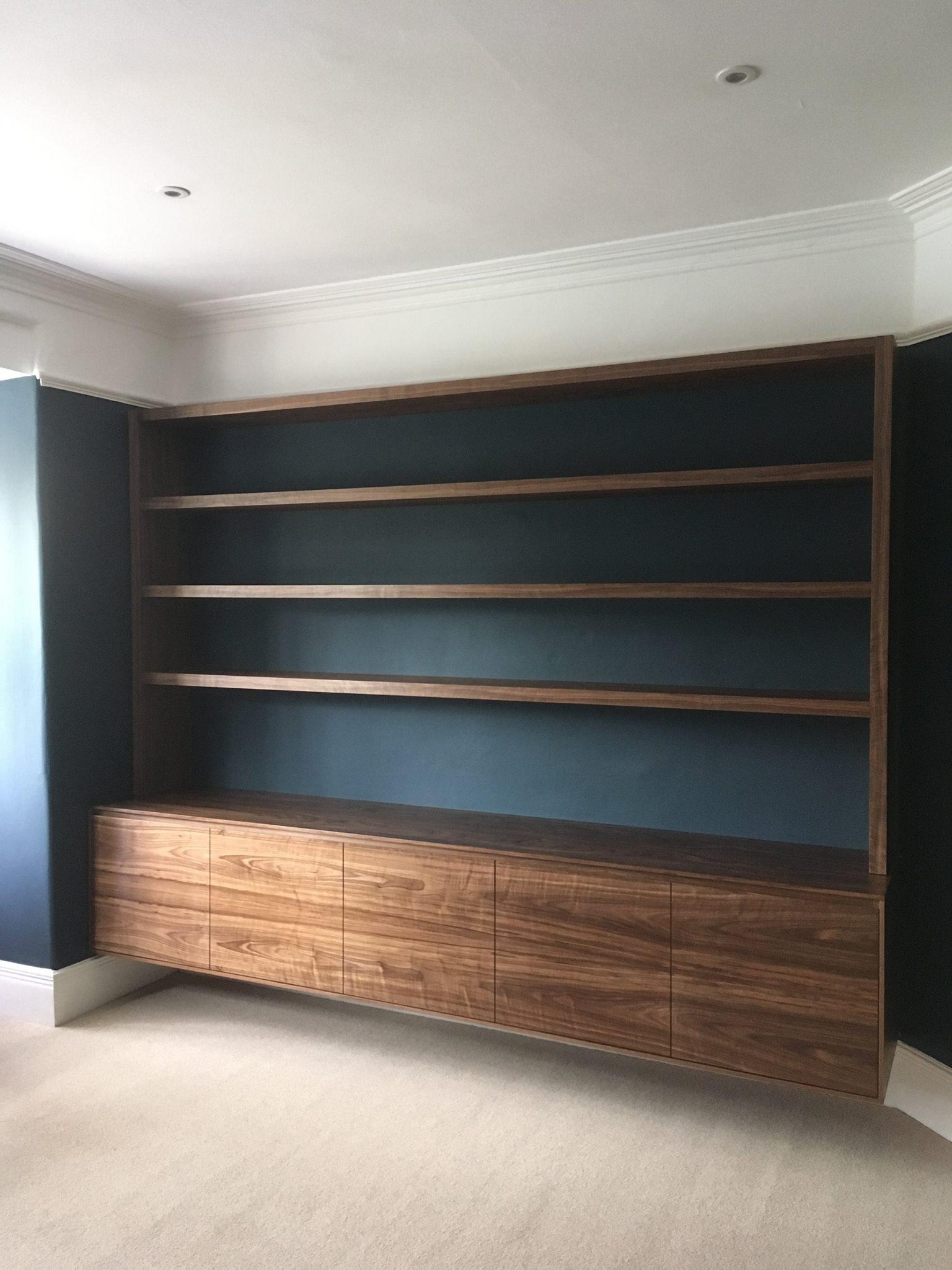 Residential: home office renovation bespoke built walnut veneered shelving & cupboards.