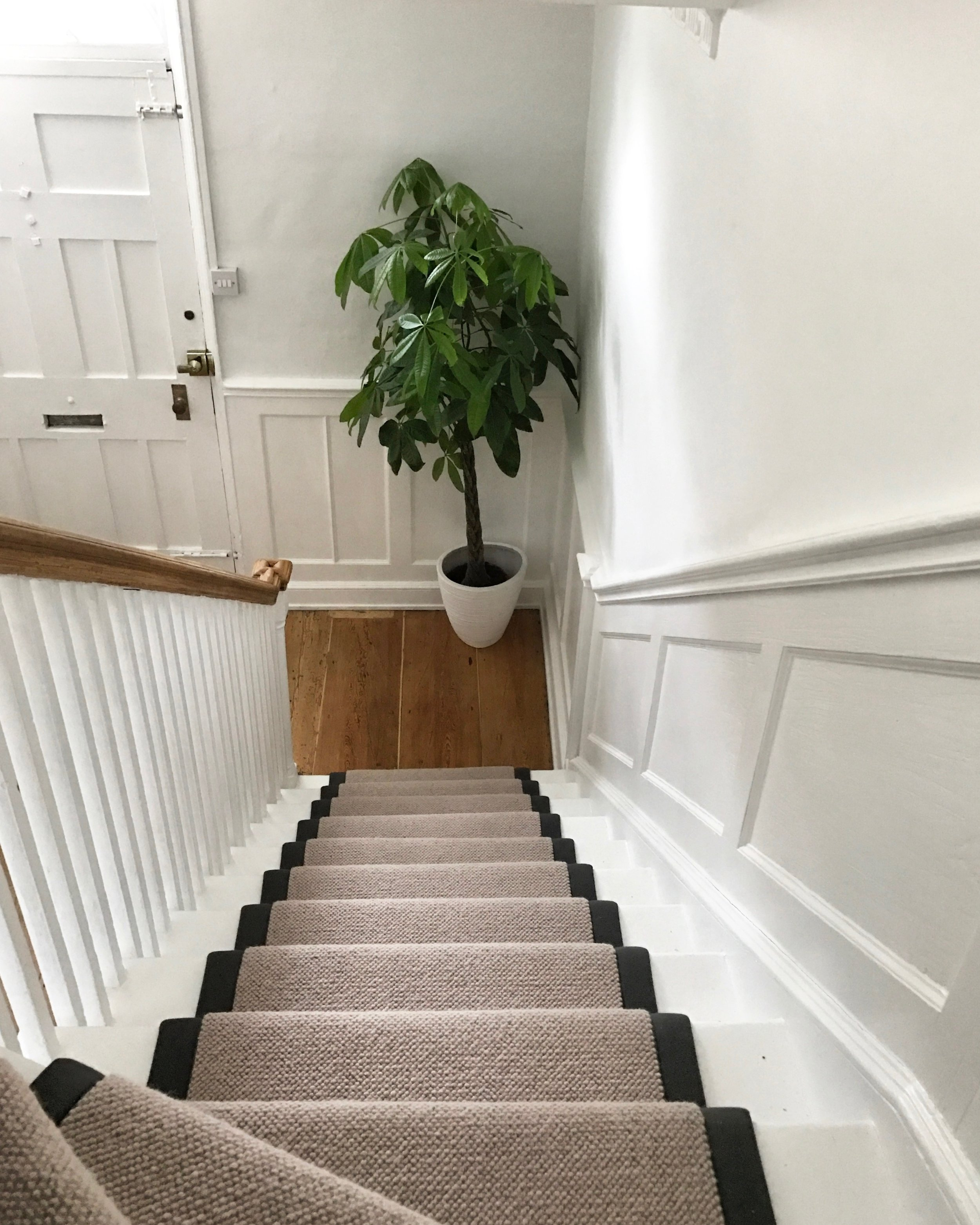 Residential: Upper & lower hallway renovation & styling including bespoke wall panelling, renovated antique floor boards, carpets 7 decoration.