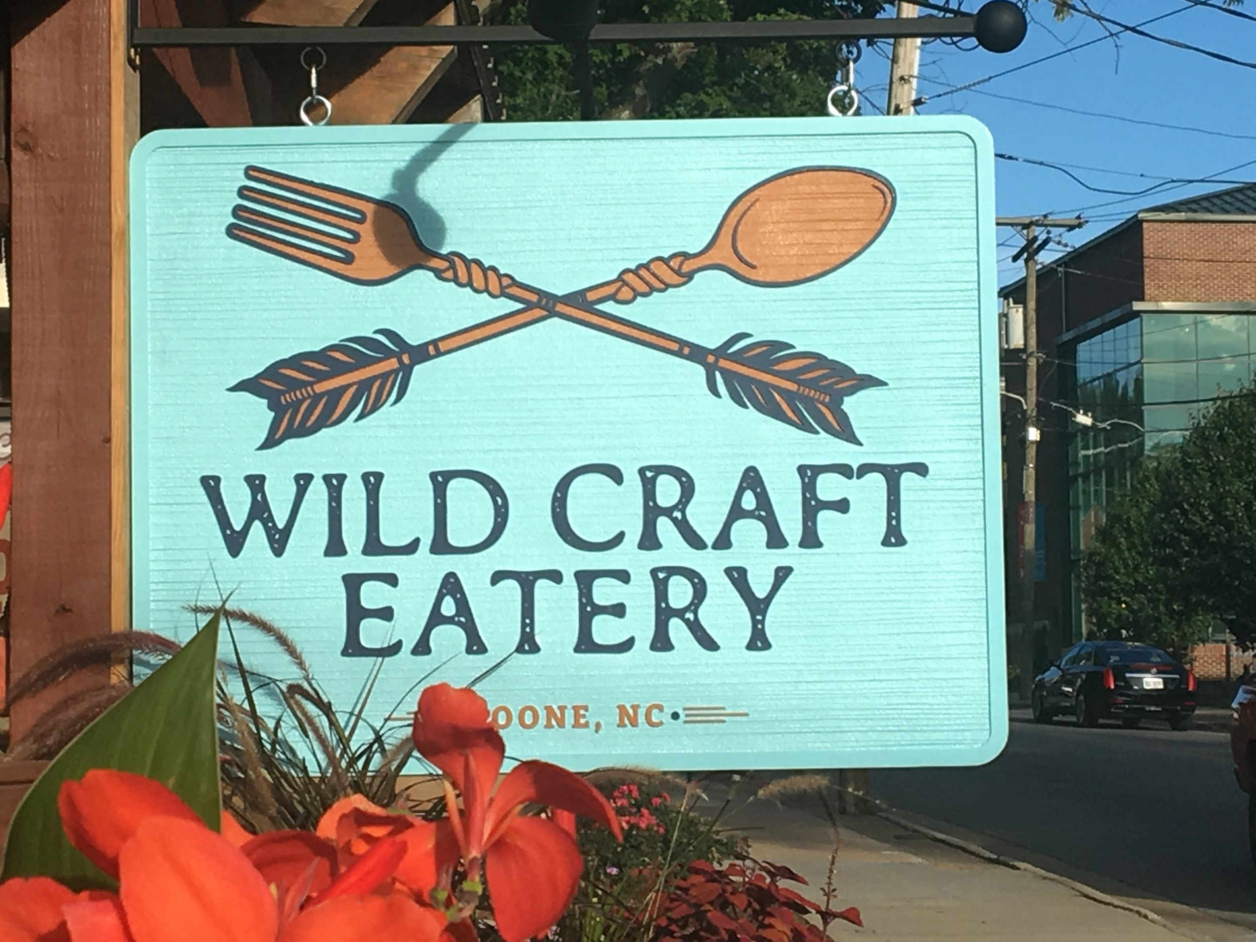 New Wild Craft Eatery logo and outdoor signage.