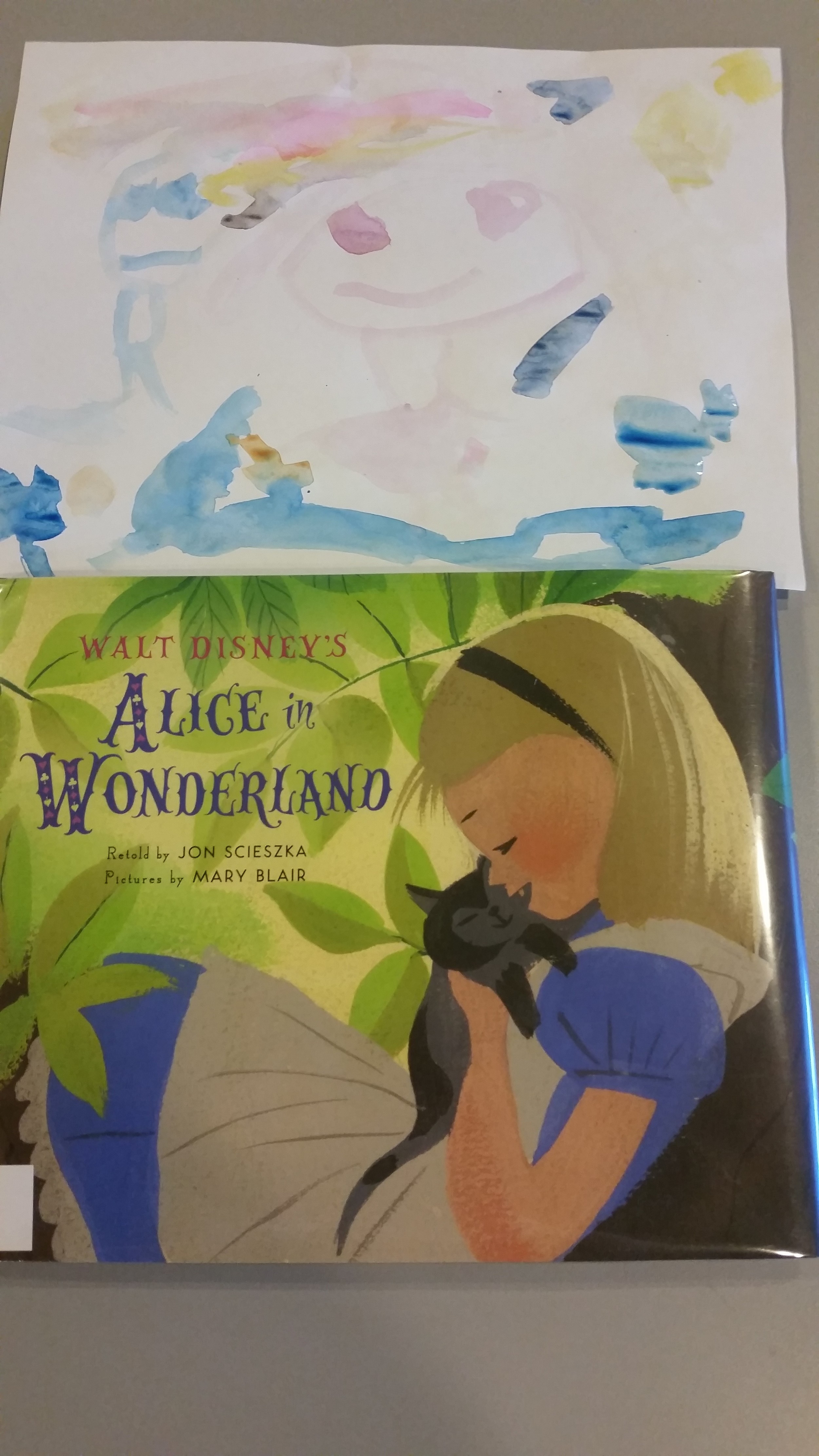 Enjoy the Alice in Wonderland cover re-interpreted in watercolors by one of our 4 year old campers.