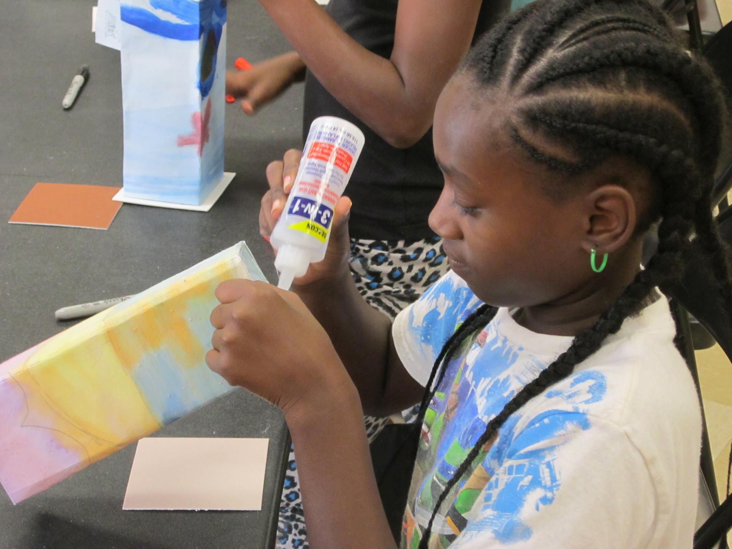 Thomas Jet Jackson girl completes the finishing touches on her lantern.