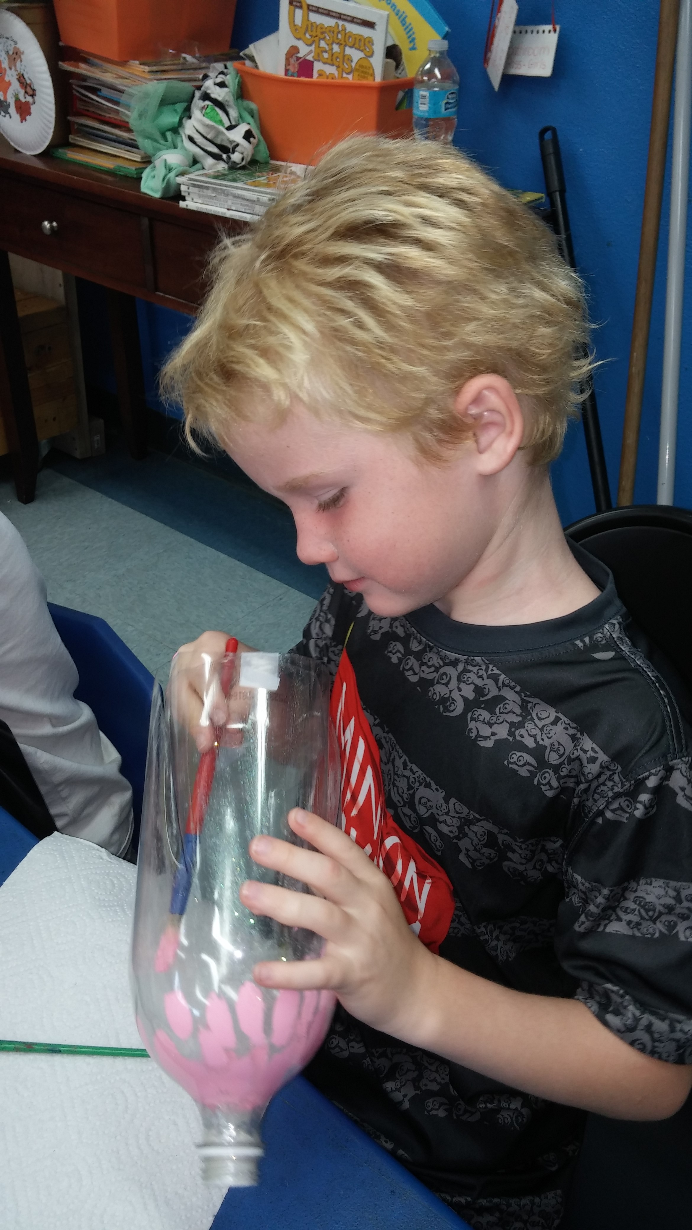 Shore Acres boy applies the finishing touches to his bottle fish