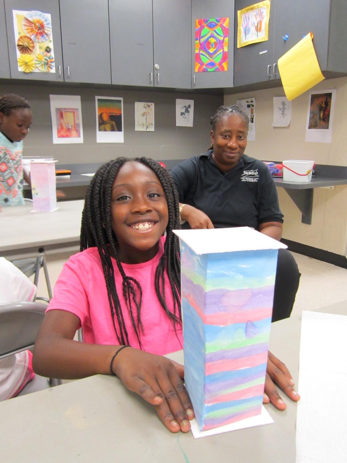 A proud Child's Park lantern maker as Yolanda looks on