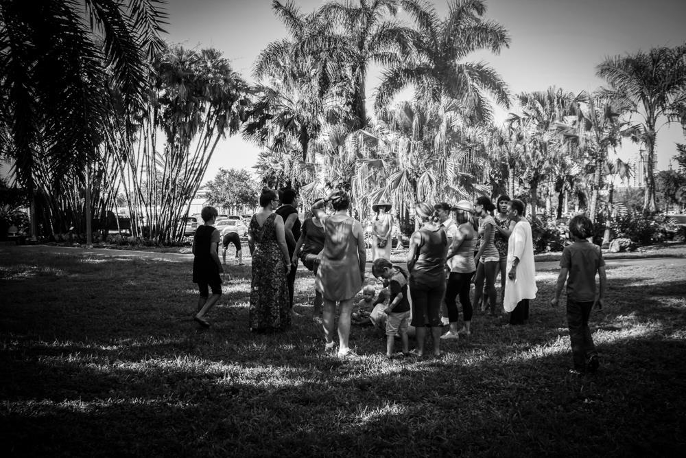 The group gathers at the Gizella Kopsick Arboretum