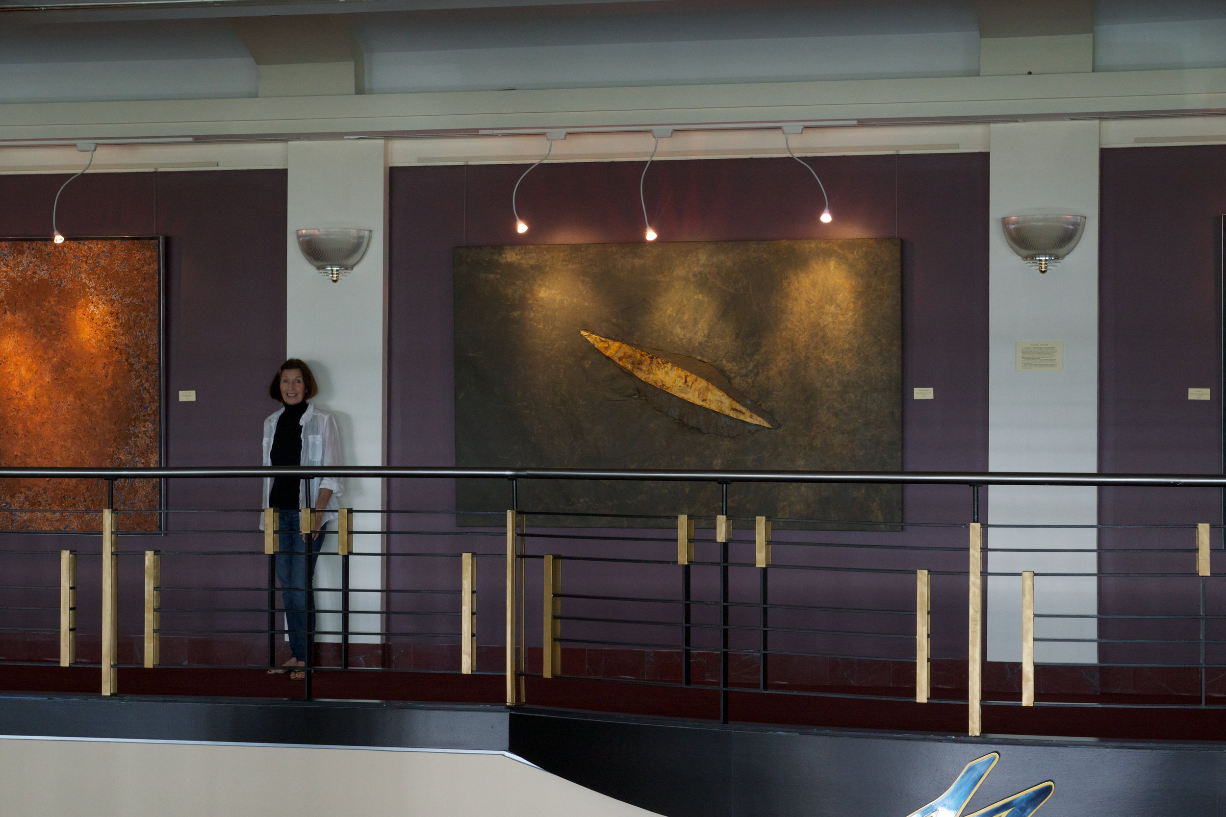 "A solo exhibition at the Mahaffey Theater in St Petersburg in 2013 showing  Planetary Movement  (on the right), mixed media on canvas, 56"" x 89"", made from a weathered canvas tarp I found in the silo during my residency at the Mary Anderson Center."