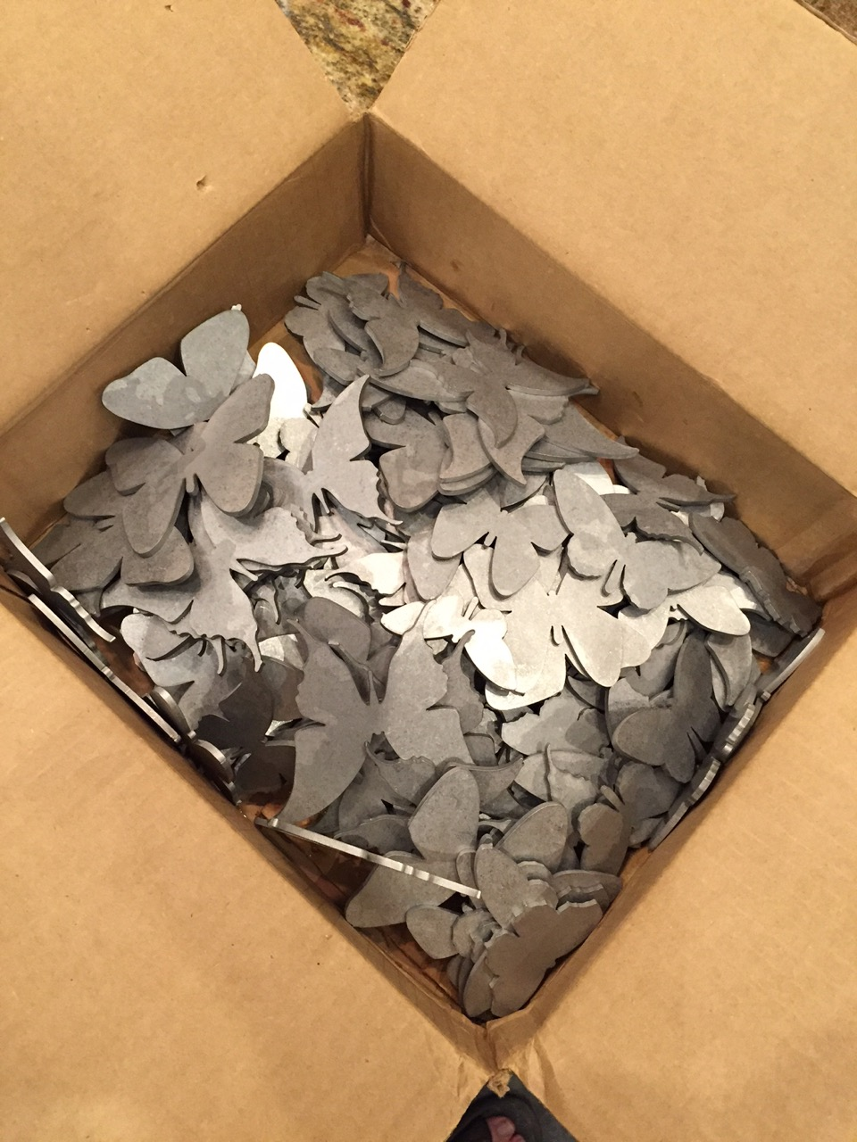 This is the box of butterflies after being tumbled in a stone tumbler to surface the pieces and remove sharp edges.  660 butterflies in all!