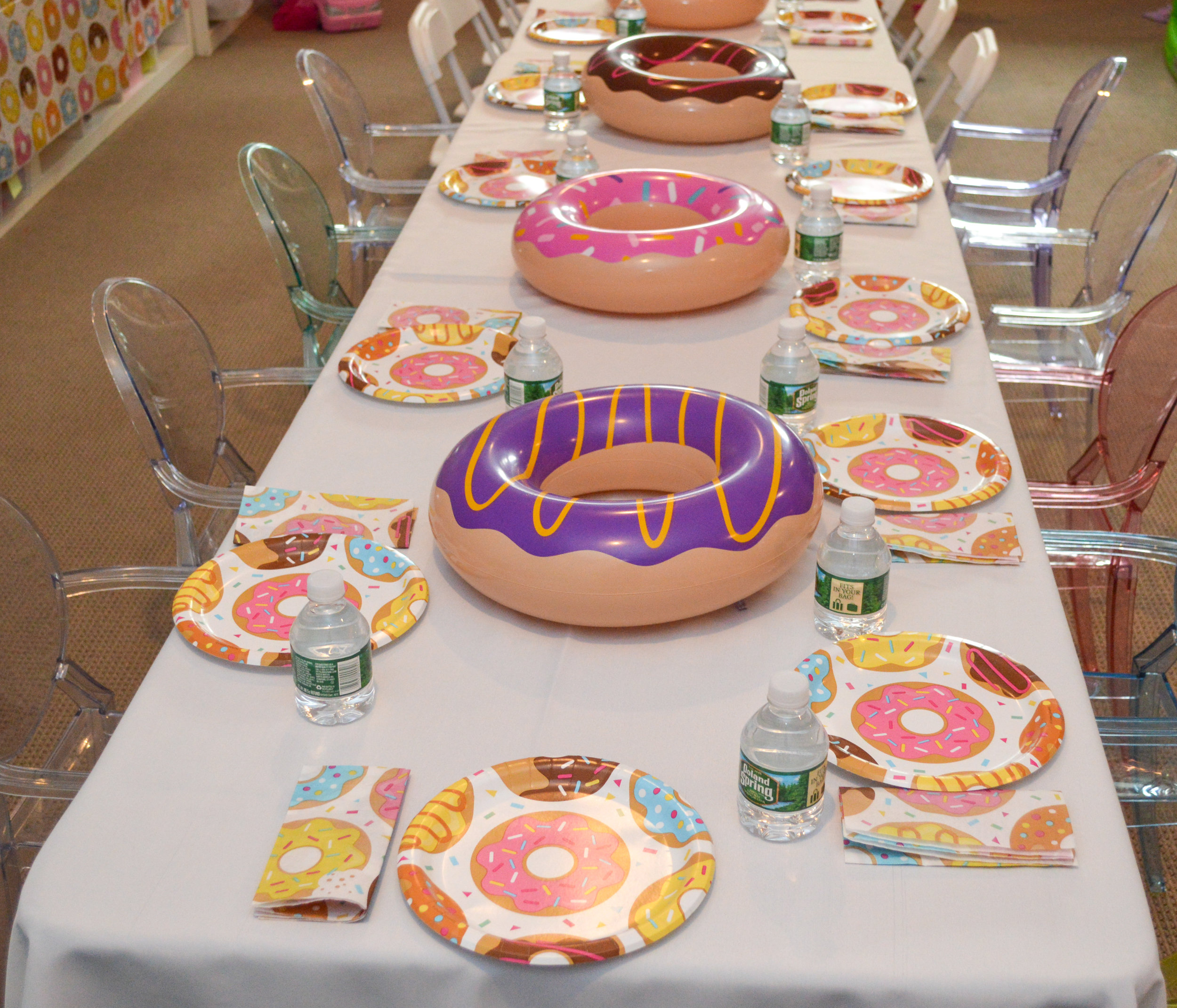 Inflatables procured by the dozen  here , and  these  grouped-to-go donut paper goods made setting the table simple.
