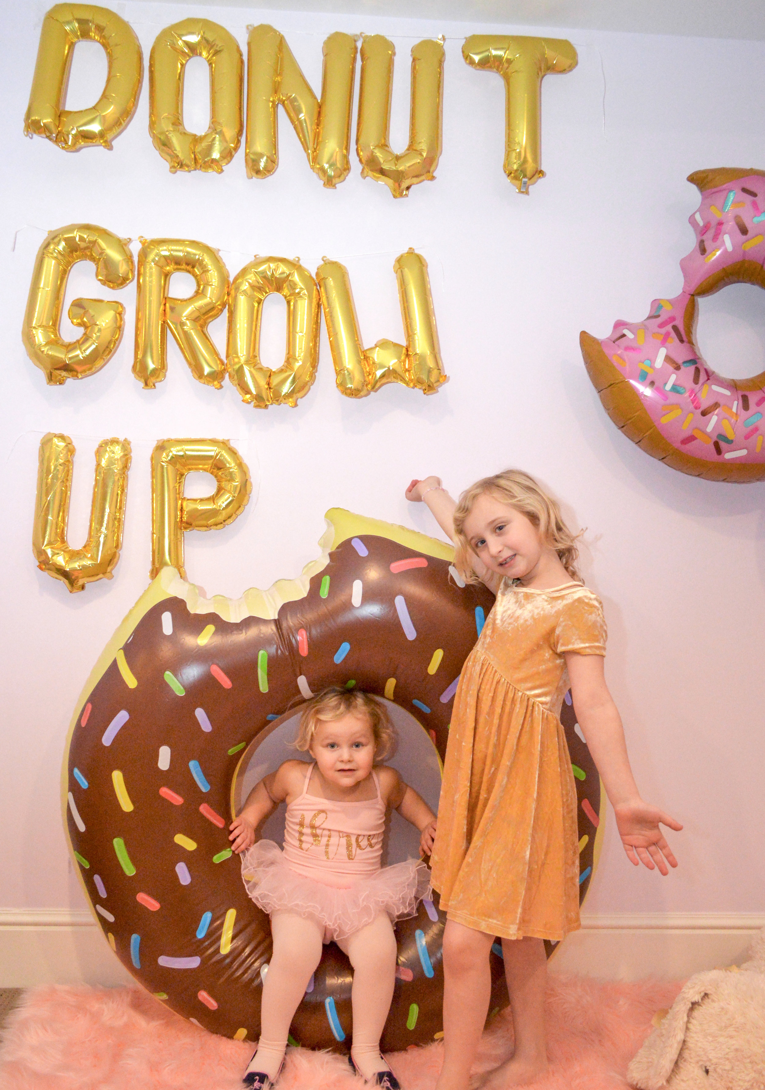"""You can find ANYTHING on  Etsy , including  this  easy-to-inflate foil balloon wall hanging and a  ballet tutu outfit  with a gold """"three"""" in the front (I got Alexa a """"seven"""" version but she wouldn't wear it, so...)"""