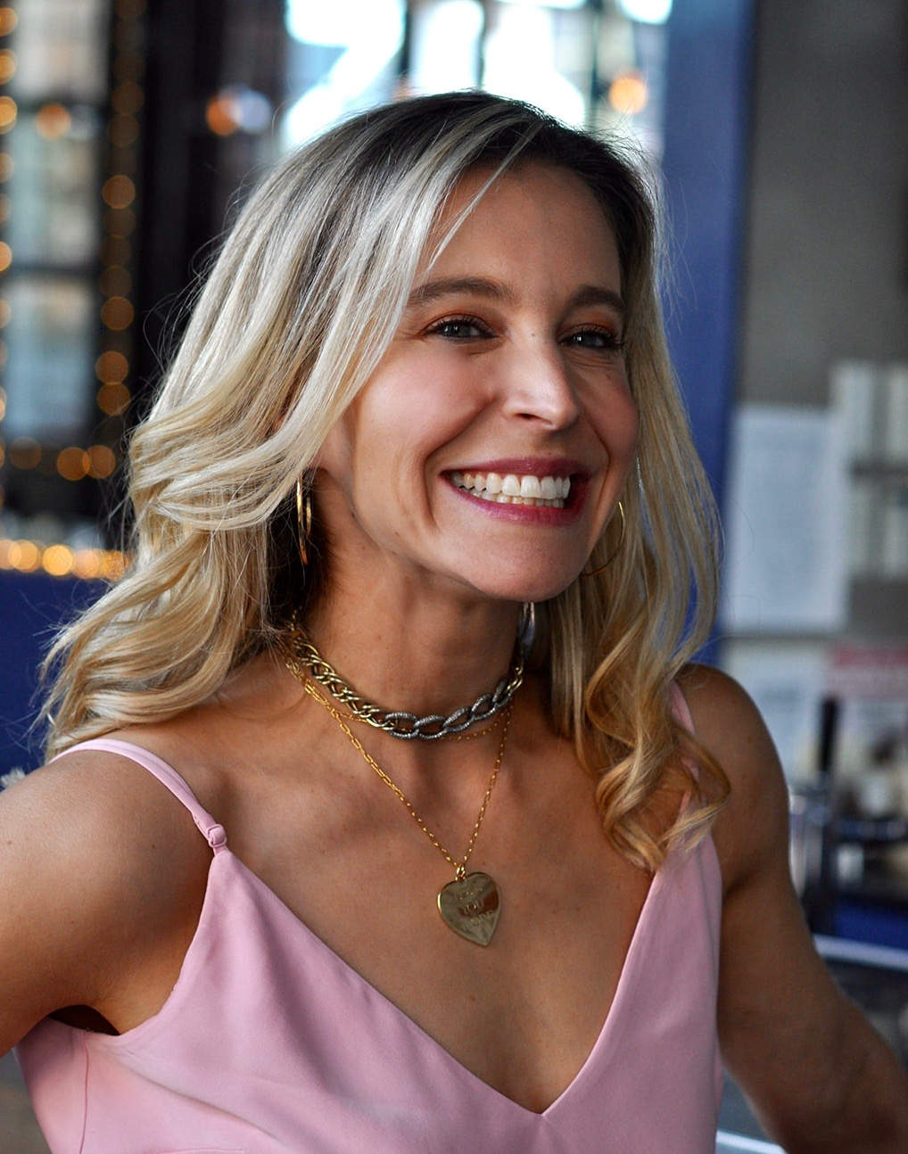 """Pure happiness, draped in  Allison Daniel  jewels- the  heart charm  actually says """"Love You More"""" on it, which immediately caught my eye because it is what Alexa says to Brian and me whenever we say """"I love you"""" to her."""