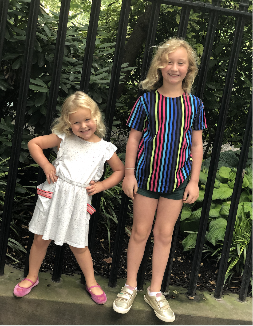 Goldie is wearing her favorite Cat & Jack dress, and Lex got this striped shirt at the Rockets of Awesome store opening event- she was so excited to wear it, even though the only bottoms she packed for our overnight trip to NYC were a pair of hunter green camp uniform shorts!