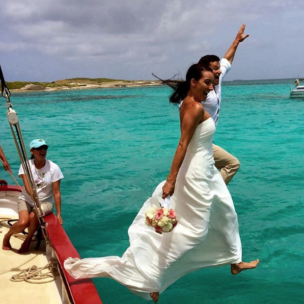"@traditionsailinganguilla captured the true essence of ""taking the plunge"" as these two newlyweds literally do so off the classic luxury of a Tradition Sailing sail boat."