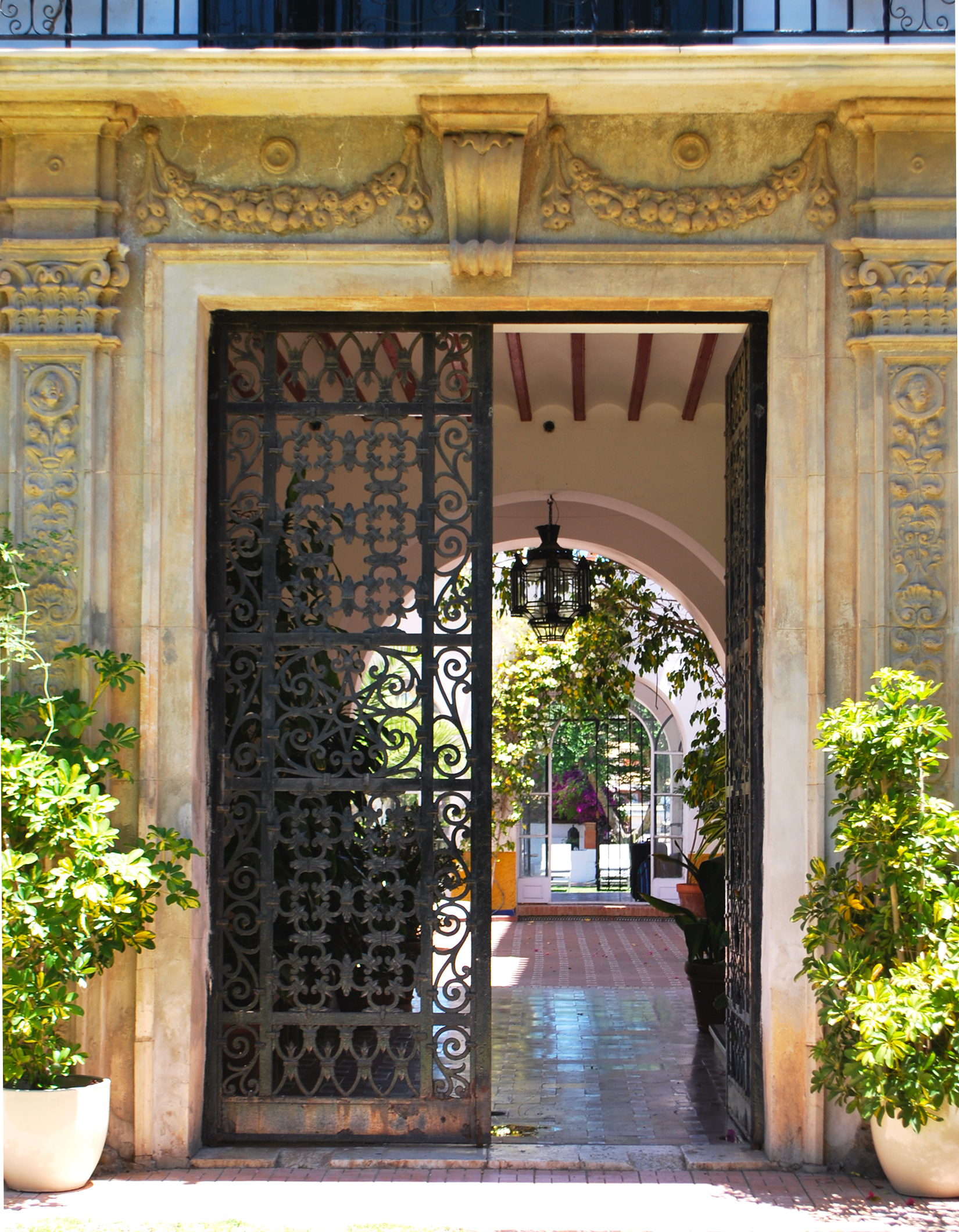 The entrance way with decorative stonework and gates.