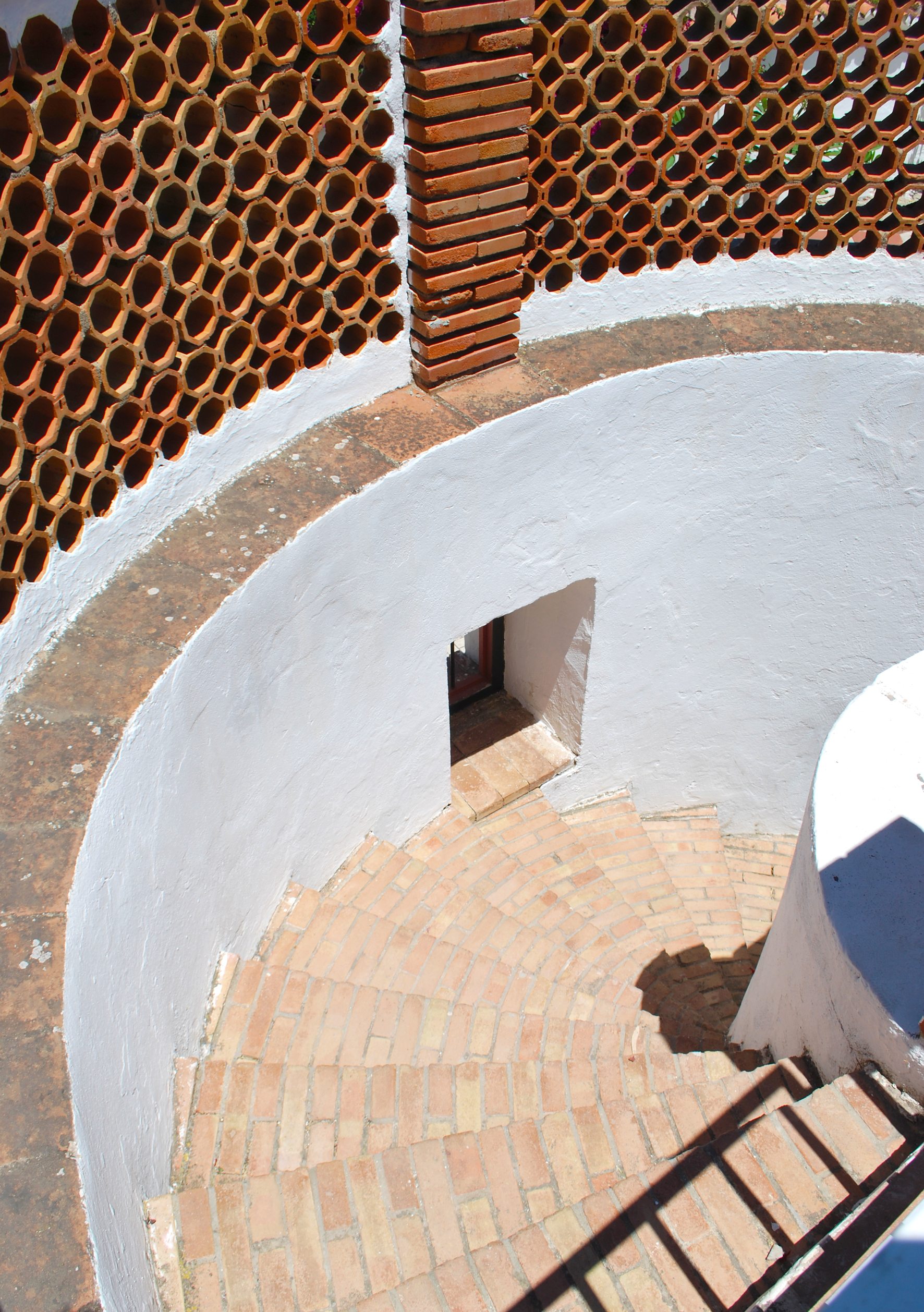 The spiral stairwell leading to the cellar.