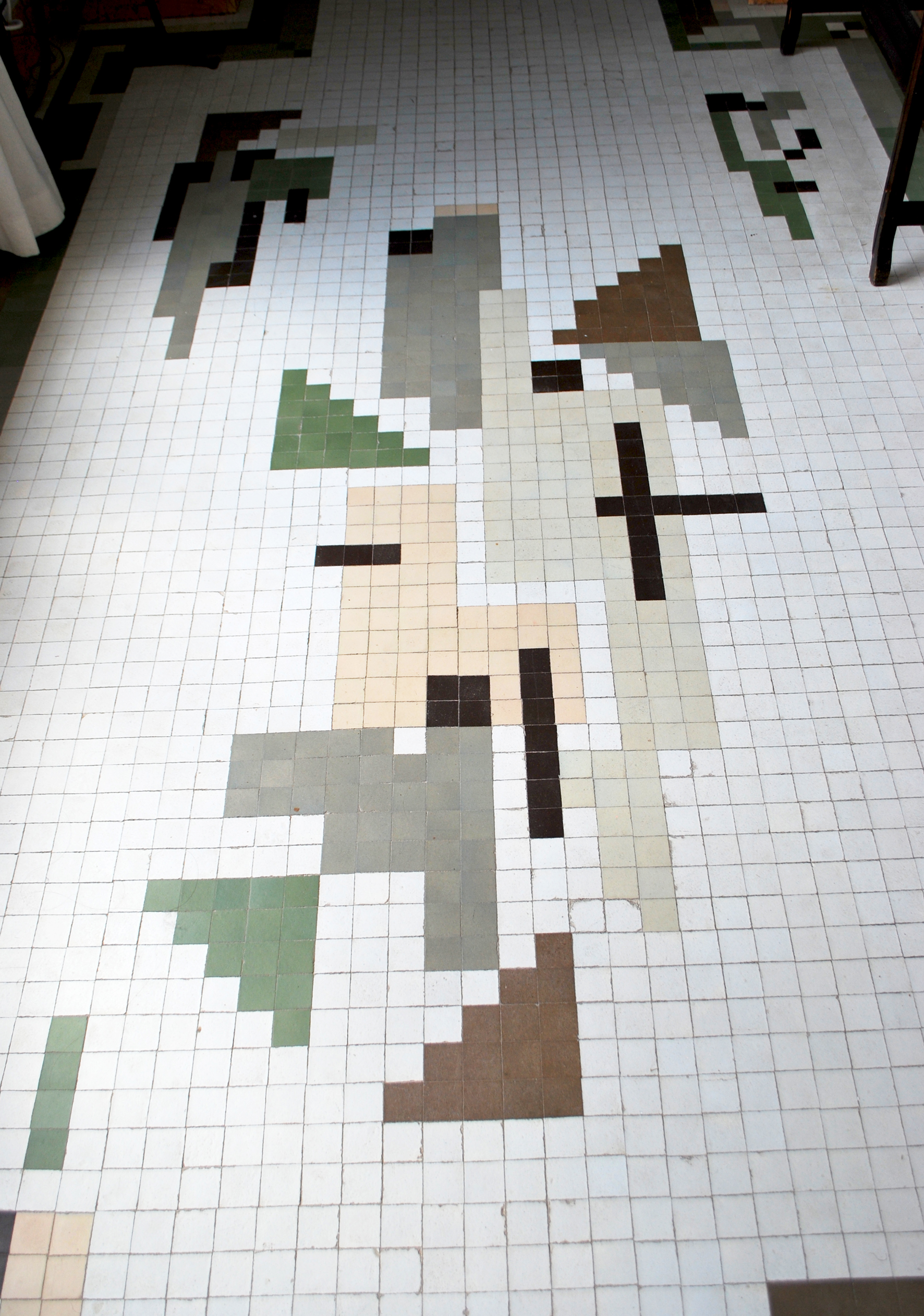 An abstract layout adorns the floor of the hallway that overlooks the central courtyard.