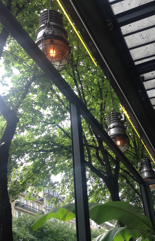 Factory-style pendants provide lighting on the terrace.