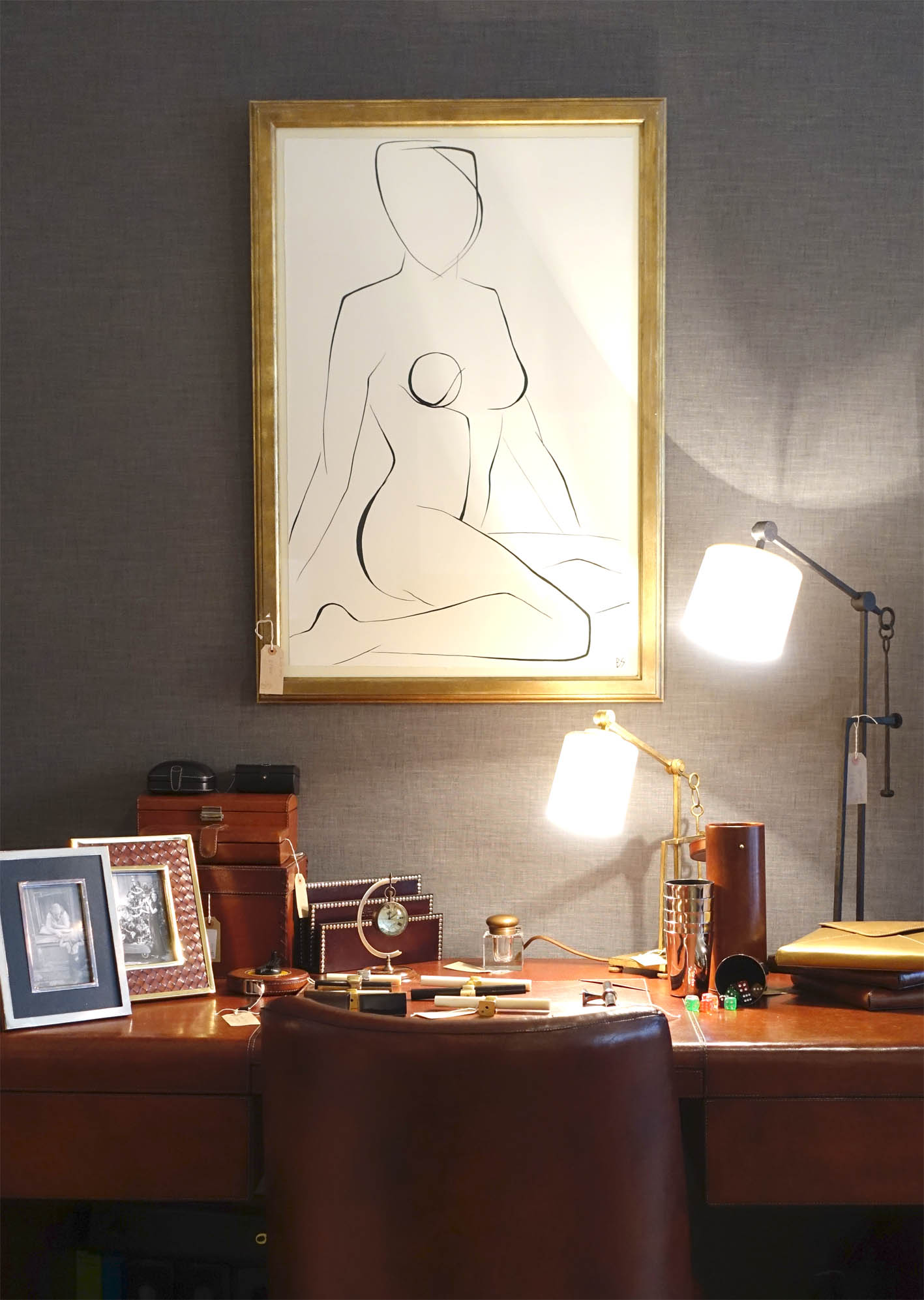 The beautiful  Metro leather-bound desk  with leather desk accessories and  Aspen table Lamps .