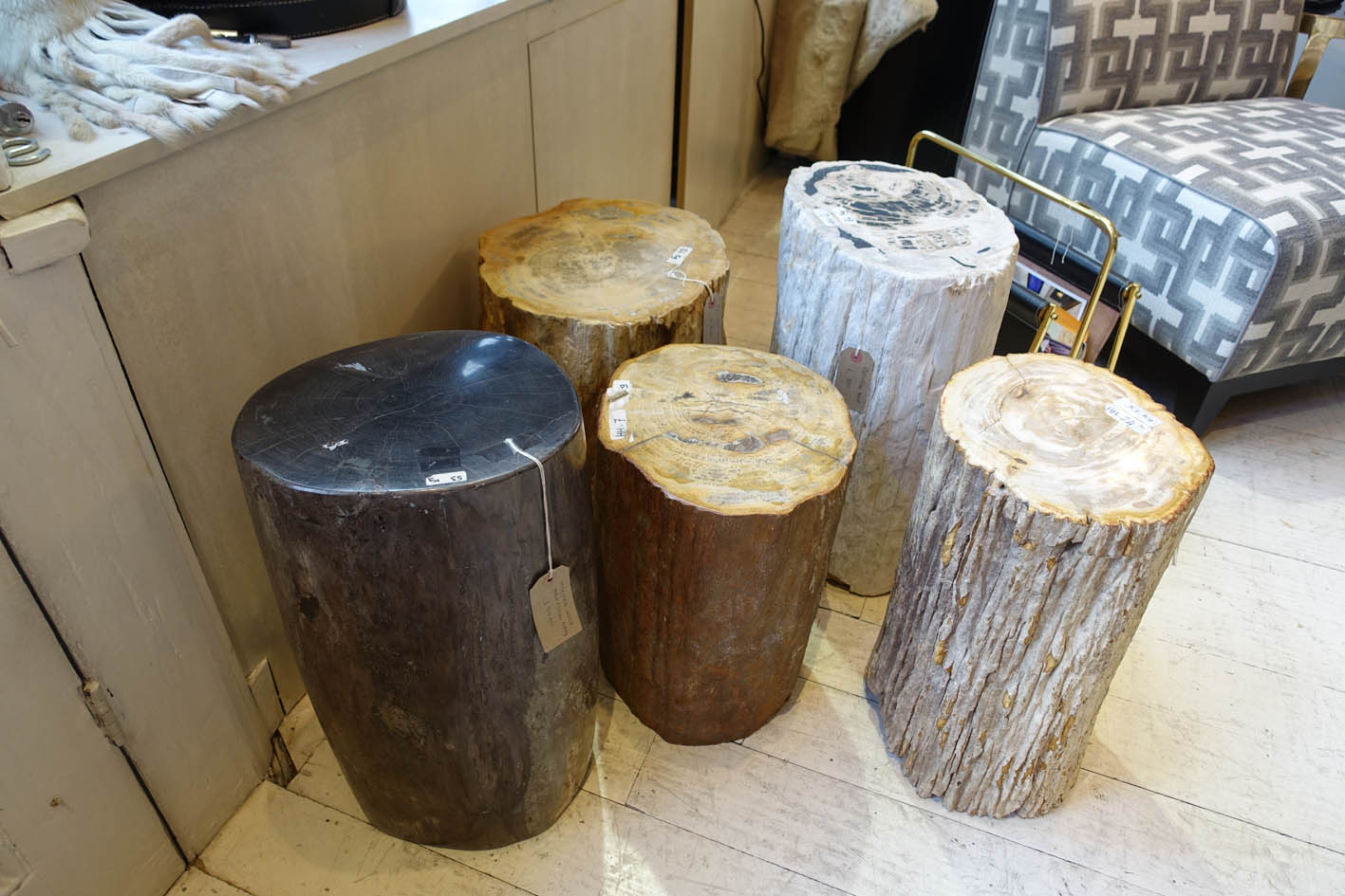 Petrified wood  is a natural product.It is the result of a tree having completely transitioned to stone by the process of mineralization though centuries. These can be used as side table or stools. these are seriously heavy and weight in excess of 60 Kilos each!